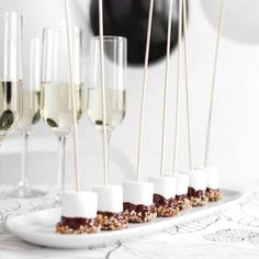 dipped marshmallows on a stick. such a cute idea.