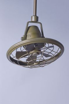 Space-saving caged ceiling fans hung in corners and hallways circa 1910 and could be swiveled and tilted to direct the breeze. This 18-inch tilting version has five steel blades and an 8-inch downrod, and is UL-rated for damp locations, like a covered porch. | @lampsplus