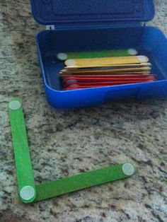 craft sticks and velcro, these can be arranged to make shapes and letters (great busy bag idea!)