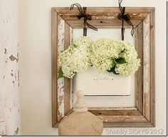 Love the tin ribboned into the frame (from Shabby Story)