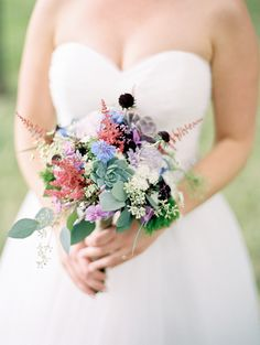 berry toned bouquet, photo by Kristin La Voie Photography http://ruffledblog.com/backyard-indiana-wedding #flowers #weddingbouquet #purple