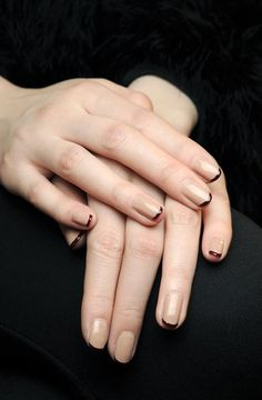 I love this nude and oxblood update to the french manicure.