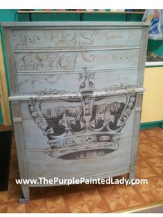 If you love whimsy- you will love this tall boy. He is hand painted in Louis Blue, Graphite & Coco Chalk Paint™ Decorative Paint by Annie Sloan and embellished a bit with some pale metallic gold…and then to provide incredible protection- both clear & dark wax. By ThePurplePaintedLady.com