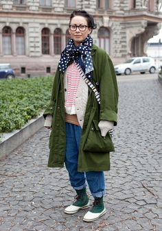 Layers to the extreme. I wouldn't want to face her in a game of strip poker. #fashion