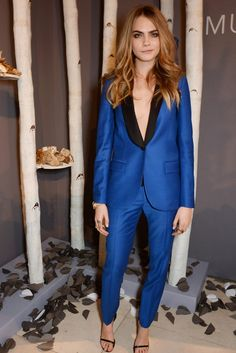 Cara Delevingne makes a sporty blue Mulberry suit look sexy at the Mulberry dinner to celebrate the launch of the Cara Delevingne collection. [Photo by David M. Benett/Getty Images]