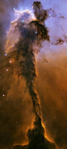 This object is a billowing tower of cold gas and dust rising from a stellar nursery called the Eagle Nebula. 7,000 light-years distant from us, the soaring tower is 9.5 light-years or about 90 trillion kilometers tall.