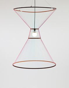 A Chandelier That Evokes The Rising And Setting Of The Sun