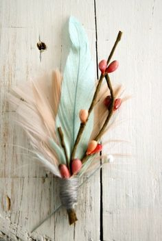 pretty feathers and twig bundle