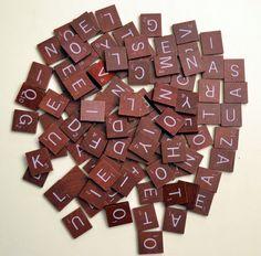 Burgundy Scrabble tiles.