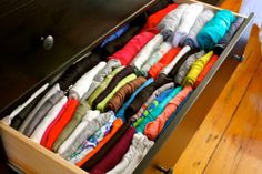 filing folded clothes