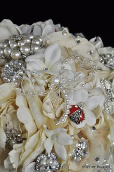 And a little something special:) Ivory Rose Brooch Bouquet #wedding #bouquet