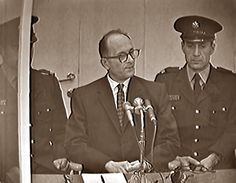 "Adolf Eichmann, the primary administrative force behind the Final Solution, during his first day on trial in Jerusalem, Israel for war crimes. Eichmann, in his capacity as a Gestapo and SD officer, worked directly with the highest levels of the SS and the Reich Main Security Office in organizing the deportation and extermination of millions of Jews and other ""undesirables."" He was hanged for his troubles in May 1962."