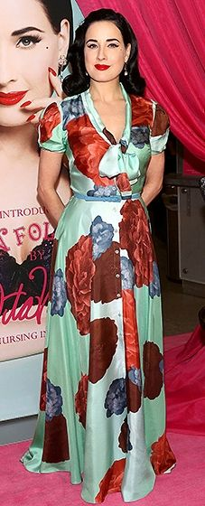 Dita Von Teese  looked retro-fabulous in a long, satin, teal gown, made all the more lovely thanks to photo-real images of flowers. As always, she added red lipstick and Mad Men-inspired waves.