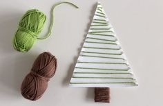 Wrapping a paper tree with thread makeandtakes.com