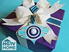 HGTV's @H. Camille Smith used HGTV HOME Fabric to create mini gift tag ornaments that add a festive touch to your gifts. #12DaysOfHGTVHOME How-To: http://www.hgtv.com/handmade/no-sew-fabric-christmas-ornaments/index.html