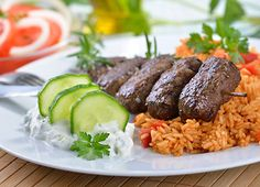 Cevapcici with Tzatziki Dip - Very popular in Balkan countries, cevapcici are easy to make. They can be enjoyed as an appetizer or arranged in sandwich with tsatziki dip.