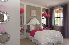 Custom built Headboard wall, featuring flanking mirror insets, and a functional ballet barre, create this adorable budding ballerinas dream bedroom.