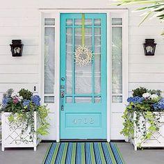 torquoise doors, lattice planters, sidelights, hydrangeas...lovely beachy entry