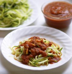 Organic zucchini spaghetti with red sauce. Top it off with meatballs!