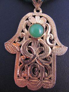 Berber silver with goldwash hamza.