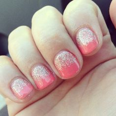 Coral gel nails with glitter!