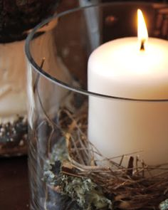 A candle in a nest. Simple, cottage-y. Love.