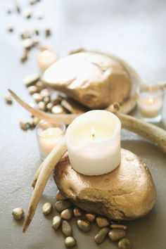 wintry #centerpieces, perfect for the Holidays - photo by Sarah C - view post here: http://ruffledblog.com/luxe-winter-wedding-ideas/ coffee tables, lux winter, river rocks, gold weddings, wedding ideas, antlers, candl, table centerpieces, winter weddings