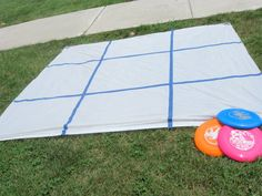 Frisbee Tic Tac Toe  Get a shower curtain from Dollar Tree and we use cheap tape to make a Tic Tac Toe grid.  Set 6 frisbees out and have the kids stand behind a line and see who had the best aim! -->LOVE THIS!