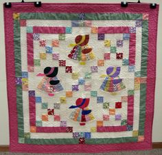 Wow. Irish Chain and Sunbonnet Sue in a baby quilt.