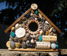 possible craft idea for my kiddo - his rock and beach treasure collection is out of control.