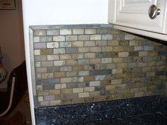 tumbled slate backsplash blue pearl granite and white cabinets