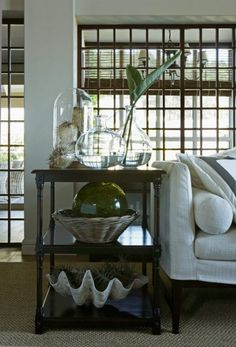 Glass cloche with coastal decor. Great giant clam shell decorating ideas