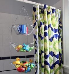 keep those bath toys wrangled with a tiered, hanging fruit basket.