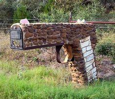 rock shaped gun mailbox