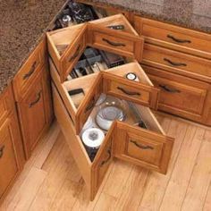 Kitchens - Corners are usually wasted spaces and hard to organise and I think this is a brilliant solution and a better idea than a bi-fold corner cupboard.