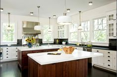White kitchen with mix-and-match cabinetry and double islands