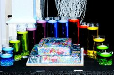 From Hi-Tech Party Productions: Love this splatter paint cake and floating candles.
