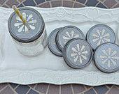 12 Pewter Daisy Cut Mason Jar Lids. $10.00, via Etsy.