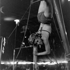 Circus girl smokes while rehearsing her stunts.    Nina Leen, 1949.