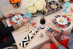 colorful dishes and gold flatware -
