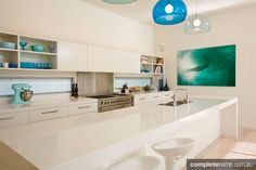 Bring some fun into a plain kitchen with some coloured hanging lights above the kitchen island.
