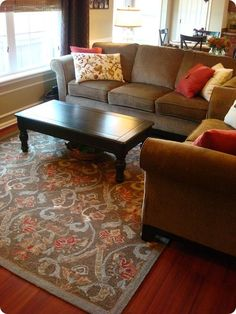 Thrifty Decor Chick: Our warm and cozy family room. This would be great decor for our small living room and she does it all on a budget!