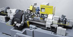 A machine model with Playmobil figures shows the mechanical effort expanded in the past on the eccentric grinding of crankshafts. #emag #crankshaft