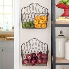 Using magazine racks to hold produce in kitchen.