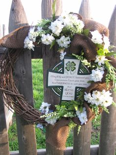 #Irish Blessings, white flowers and brown #burlap dot this wreath  www.facebook.com/wreathswithareason