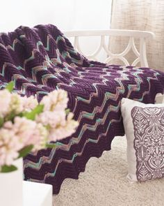 Simple 2-row ripple blanket in a fun and dynamic stripe pattern.