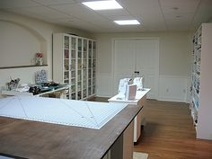 Sewing room. I would want to decorate with a little color, but I love all the storage and working space!