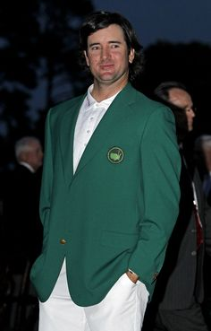 Bubba Watson poses with his green jacket after winning the Masters golf tournament following a sudden death playoff on the 10th hole Sunday, April 8, 2012, in Augusta, Ga.