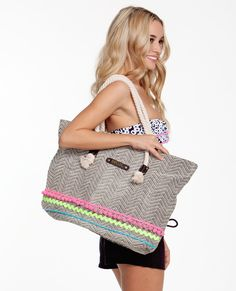 Pack your beach towel and and a good book into this cute Haleiwa Beach Bag.