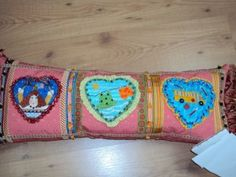 From the Artists' Collection, these Mile HIgh Princess monthly heart shaped ornaments were put on pillows.  Series from the Chaparral Needleworks and these stitched by Jeannie H.N.  On Living With Needlepoint blog